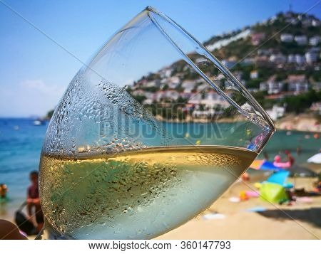 A Glass Of Refreshing Cold White Wine Close Up On Beach Restaurant.ice Beverage With Chardonnay Or S