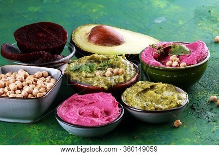 A Variety Of Colored Hummus, Beetroot Hummus, Hummus With Avocado On Background. Veggie Clean Eating