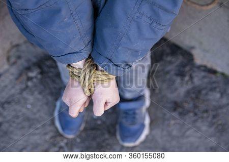 Bound Hands Of A Child