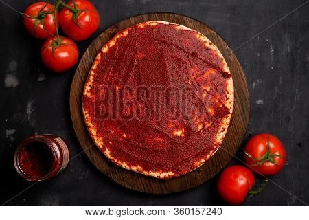 Ready-made Pizza Base With Tomato Paste And Basil