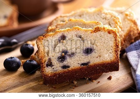 Closeup Of Sliced Blueberry Streusel Sweet Bread With Fresh Berries On A Wooden Cutting Board