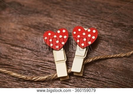Two Clothespins With Hearts On A Rope. Symbol Of Love. Free Space