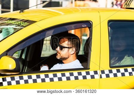 Car In Traffic, Modern City Taxi Service. Detail Of Taxi Driver In Traffic Jam In The Capital City O