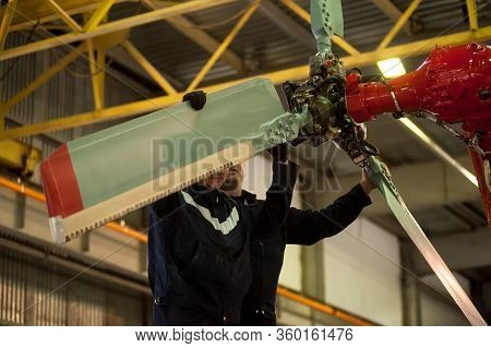 Tyumen, Russia - June 19, 2019: Aircraft Repair Helicopter Utair Engineering Plant. Aircraft Mechani