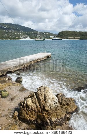 The View Of Rocky Landscape And The Concrete Pier With Lindbergh Bay In A Background On St. Thomas I