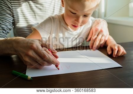 Father Teaching Child To Write Or Draw
