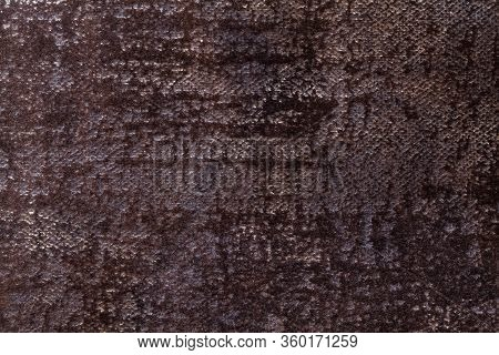 Dark Brown Fluffy Background Of Soft, Fleecy Cloth. Texture Of Black Textile Backdrop With Shiny Pat