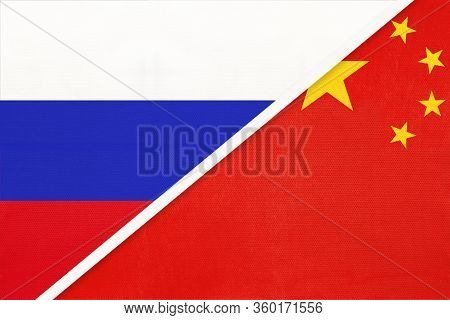 Russia Vs China Or Prc National Flag From Textile. Relationship Between Asian And European Countries