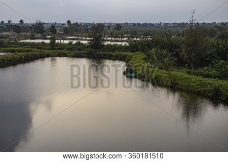 Rural Scenery With Houses, River, Vegetation On Long Tau (song Long Tau) River Banks In Suburb Of Ho