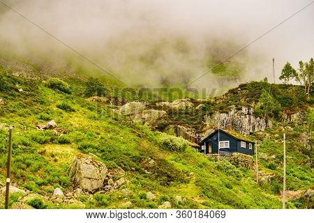 Norwegian Country House Cabin In Mountains. Foggy Misty Landscape In Norway, Scandinavia