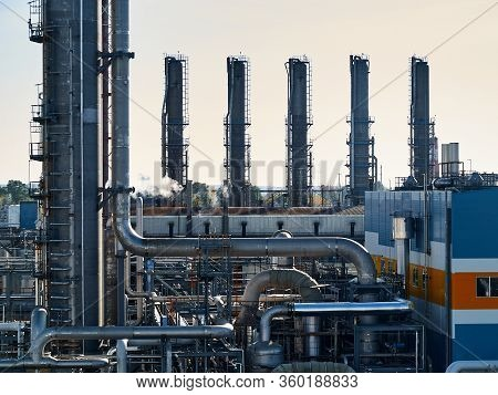 Oil And Gas Refinery Industrial Plants With Silhouette Image. Chemical Plant In Backlight Wuth Copys