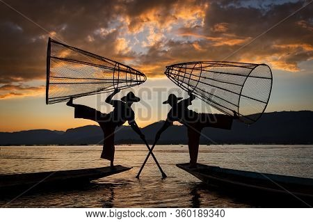 Intha Fisherman Posing With Conical Nets At Sunset, Inle Lake In The Nyaungshwe Township Part Of Sha
