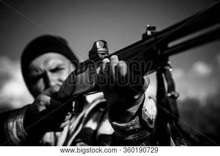 Close Up Snipers Carbine At The Outdoor Hunting. Hunting Gun. Hunter Aiming Rifle In Forest. Hunter