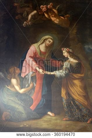 ROME, ITALY - SEPTEMBER 03,2016: Virgin Mary with St Rosalia and angels altarpiece by Orsola Noletti in Chapel of the Blessed of the First Order of Minims, Basilica di Sant Andrea delle Fratte, Rome