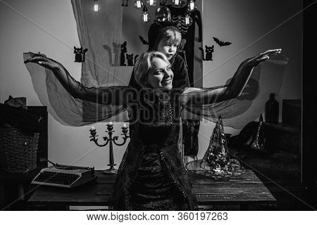 Halloween Decoration And Scary Concept For Happy Family. Halloween Holiday Concept - Mother And Son.