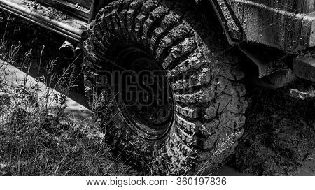 Best Off Road Vehicles. Off-road Vehicle Goes On The Mountain. Bottom View To Big Offroad Car Wheel