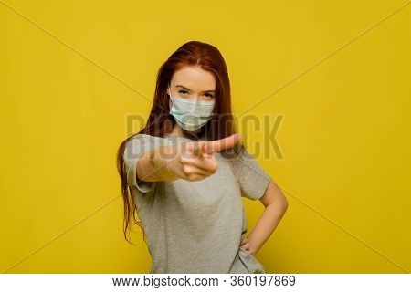 A Portrait Of Young Anxious Woman In Panic In Facial Protective Mask. Advertising Of Safety Mask. A