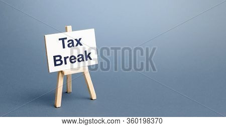 Tax Break Easel. Avoiding Or Deferring Tax Payments. Refund Of Taxes Deductions According To Law. St