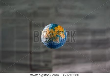 The Concept Of The World Press. Focus Is The Layout Of The Planet Earth On The Background Of A Defoc