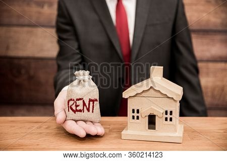 A Housing Concept Of A Landlord Or Home Owner Demanding Or Paying Rent For A Real Estate Property