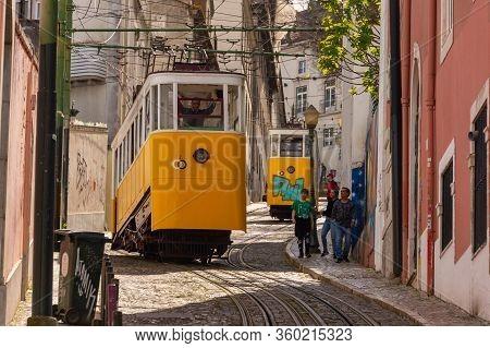 Lisbon, Portugal - 8 March 2020: Elevador Da Glória Yellow Funicular In Bairro Alto District