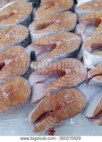 Fresh Salmon, Fillet And Whole, On Ice Display In Supermarket