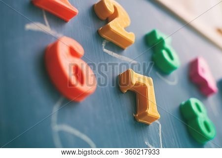 Learning Numbers On A Blackboard With Colorful Magnets And Handwriting On Blackboard During Homescho