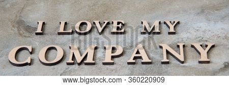 I Love My Company , Writen Wooden Letters On Stone Background