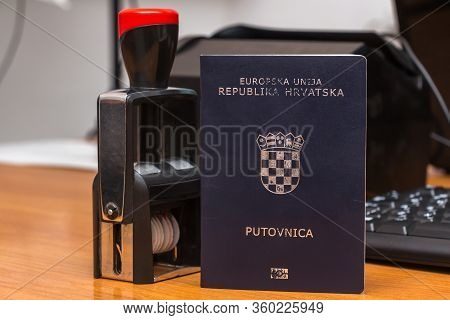 Close-up Of A Croatian Biometric Passport With A Border Date Stamper At The Interstate Border In Eur