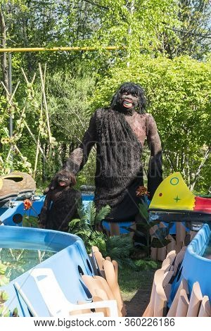 Russia, The City Of Novosibirsk, The Zoo On May 21, 2014. The Statue Of A Primitive Caveman Dressed