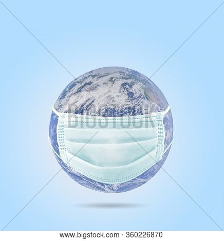 On Planet Earth, A Medical Mask To Protect Against The Coronavirus Epidemic. Concept Of A Global Vir