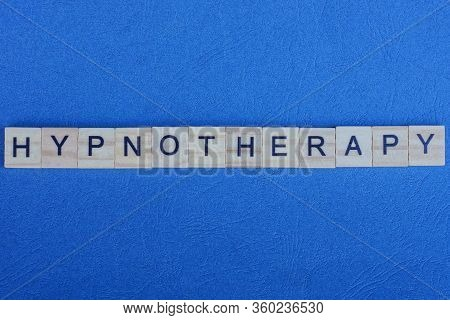 Word Hypnotherapy Made From Gray Letters Lies On A Blue Background