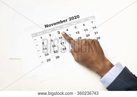 African Man Voter Showing Date Of Elections In The Usa 2020, White Background, Copy Space