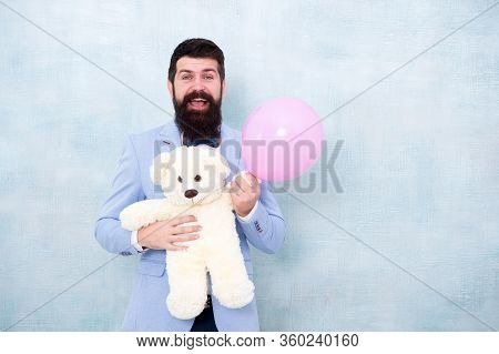 Womens Day. Greetings 8 March. Stereotypical Gifts. Valentines Day. Romantic Man With Teddy Bear And