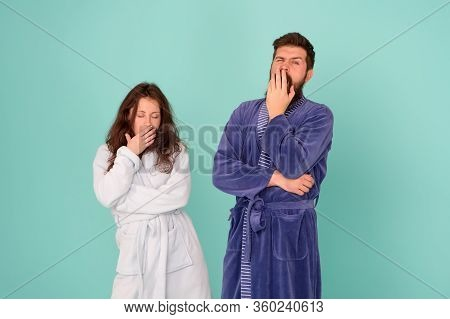 Need More Sleep. Yawny Couple In Love Blue Background. Sexy Woman And Bearded Man Give Yawn. Tiredne