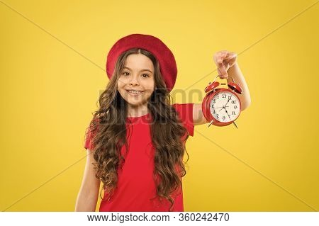 Controlling Personal Time. Schedule And Time. Set Up Alarm Clock. Child Little Girl Hold Red Clock.
