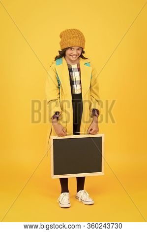 Back To Student Life. Little Girl In School Uniform On Yellow Background. Small Child Hold School Bl