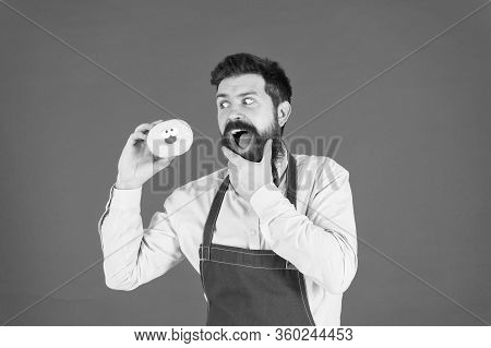 Dessert Made With Passion. Professional Baker Enjoy Baking Doughnut Dessert. Bearded Man Having Fun