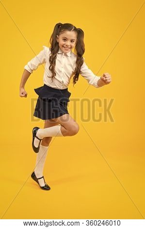 Being In A Hurry. Active Small Child In Formal Wear Rushing To School On Yellow Background. Happy Gi