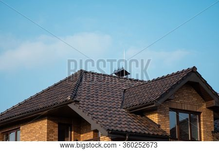 Brown Natural Tile Roof. Modern Types Of Roofing Materials. Roof Of The House, Natural Roof Tile Aga