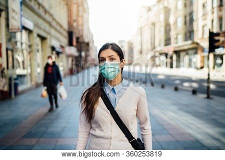 Suspicious Young Adult Walking In Public Space During Pandemic.effect Of The Covid-19.protective Mea