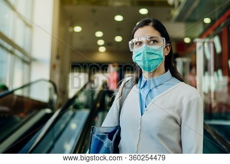 Careful Young Woman Going To Work  During Coronavirus Covid-19 Outbreak.working Businesswoman With P