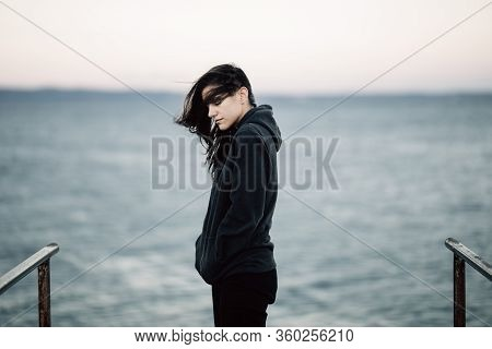 Stressed Sad Woman In Bad Mood Overthinking Problems,looking At The Sea/ocean.person Being Alone.soc