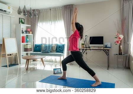 Asian Woman Making Yoga Exercise For Step Away From Their Computers To Take Mid-day Exercise Breaks