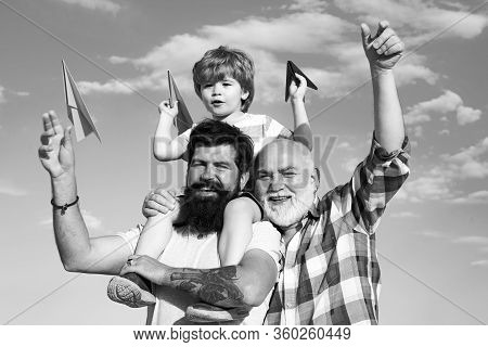 Men Generation: Grandfather Father And Grandson Are Hugging Looking At Camera And Smiling. Three Dif
