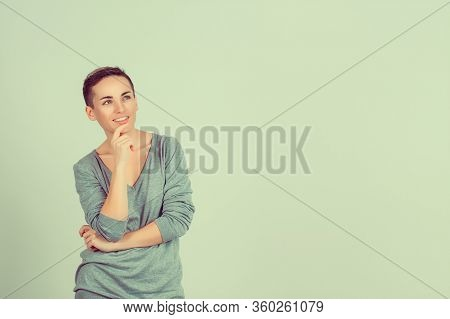 Woman Daydreaming. Thinking. Closeup Portrait Head Shot Happy Mixed Race Daydreaming Smiling Cute Co