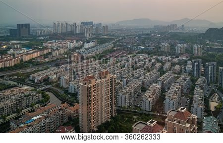Suzhou China - May 2, 2010: Aerial Evening Shot Over Many Rows Of Gray And Brown Residential Highris