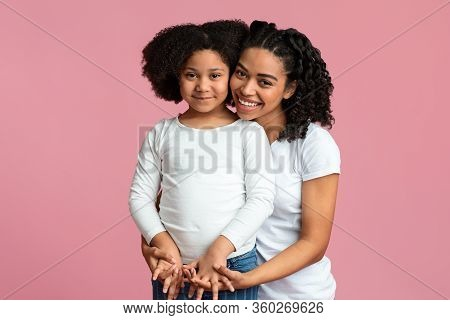Children Adoption Concept. Happy Black Woman Posing With Her Foster Child, Holding Hands And Cuddlin