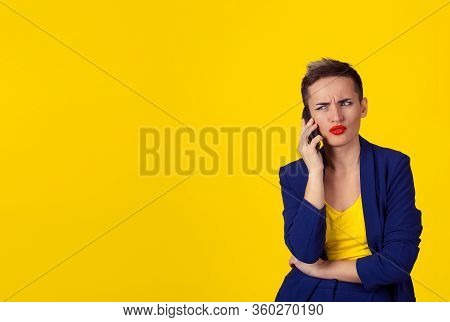 Skeptical Business Woman In Disbelief Talking On Phone Deciding What To Answer Looking To Copy Space
