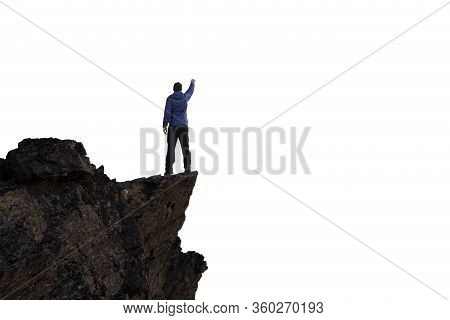 Adventurous Man Hiker Standing On Top Of A Steep Rocky Cliff. White Background Isolated Cutout. Perf